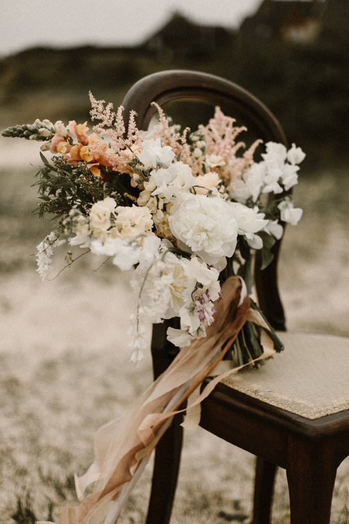 This bohemian beach wedding inspiration shoot features two gorgeous bohemian-inspired wedding looks, fabulous designer shoes, and an oceanfront reception.