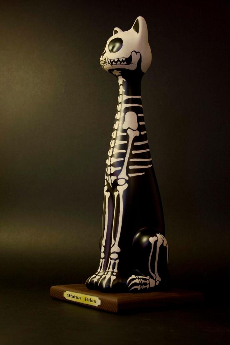 Ceramic cat skeleton.. $75.00, via Etsy.