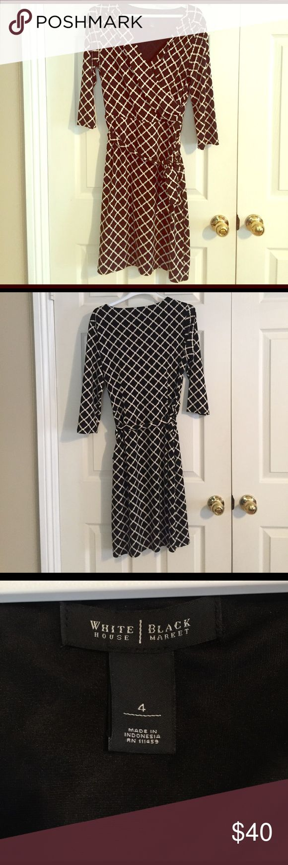 White House Black Market faux wrap dress This dress is very flattering as all wrap dresses are. It can be worn for so many events! It has 3/4 sleeves and hits to about the knee. White House Black Market Dresses