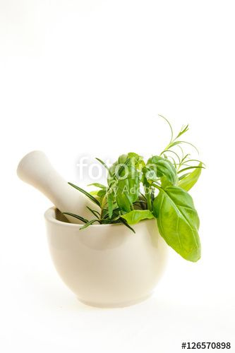 mortar with fresh herbs isolated on a white background
