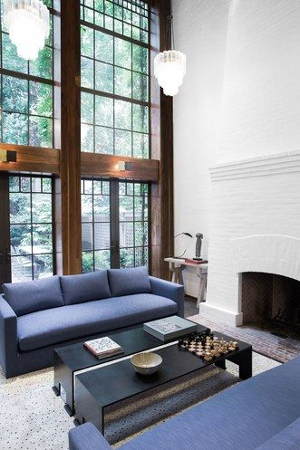 Natural wood beams add warmth to this living room | archdigest.com