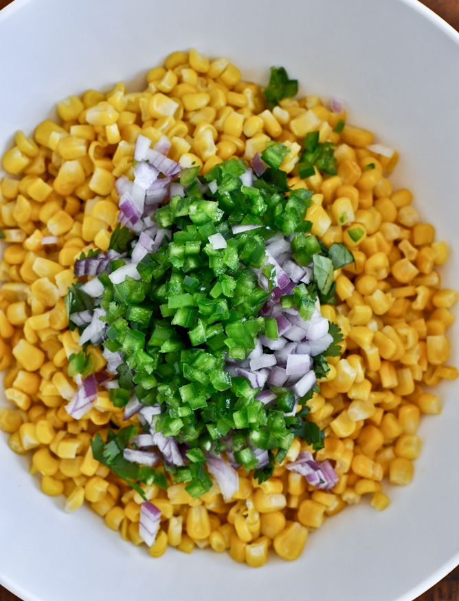 Chipotle's corn salsa makes a big bowl 1 12-ounce bag of frozen sweet yellow corn, defrosted and drained 2 medium-sized jalapenos, seeded and chopped (leave in some seeds for more heat if desired) 1/2 red onion, finely chopped (about 1/3 cup) 3/4 cup fresh cilantro, torn or chopped the juice of 2 (juicy!) limes 1/2 teaspoon salt 1/2 teaspoon pepper