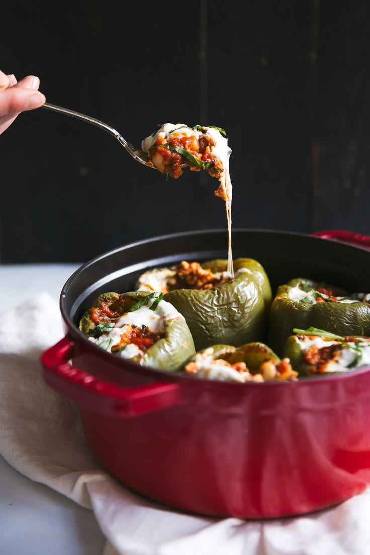 Delicious Italian style turkey stuffed bell peppers with spinach, white beans, brown rice and a fresh tomato basil sauce! A balanced healthy dinner with fiber & protein.