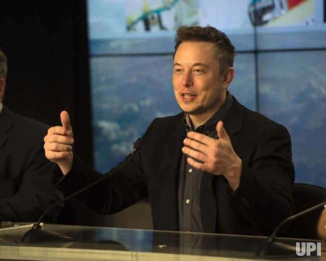 "SpaceX CEO Elon Musk replies to questions at a briefing following the successful flight of a ""flight proven"" booster from the Kennedy Space…"