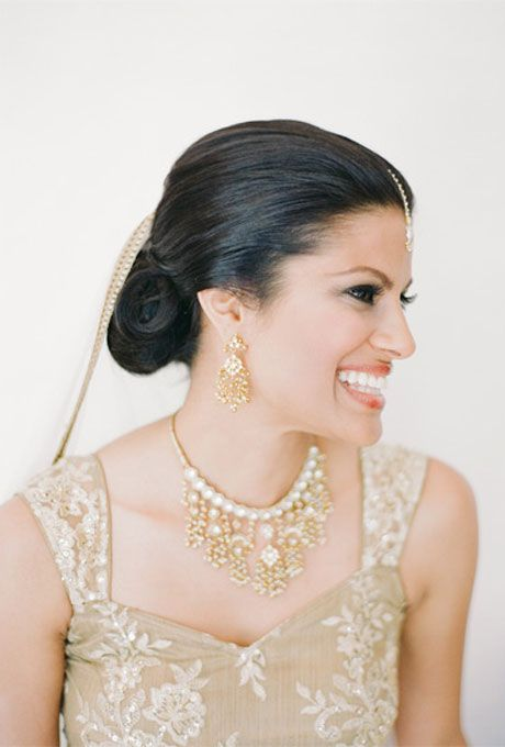 Brides.com: Wedding Hairstyles that Work Well with Veils. A Sleek, Low Bun Wedding Hairstyle. A glossy low bun is stunningly sophisticated, and the love the pop of gold detail along this bride's veil is a great touch.  Browse more wedding updos.