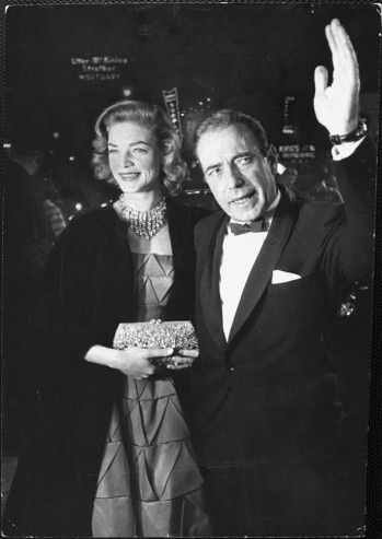 """Lauren Bacall and Humphrey Bogart wave to fans outside the RKO Pantages.  He was a Best Actor nominee for """"The Caine Mutiny""""  1955.   LIFE Magazine's Best Oscar Photos, From the Golden Age of Hollywood - LIFE"""