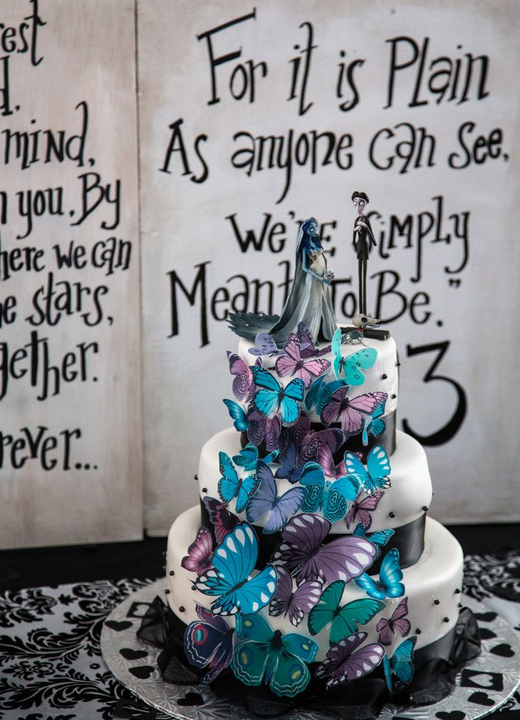 "Amazing ""Corpse Bride"" wedding cake by our wonderful friend for our wedding. Loved the ""Nightmare Before Christmas"" lyrics behind the cake."