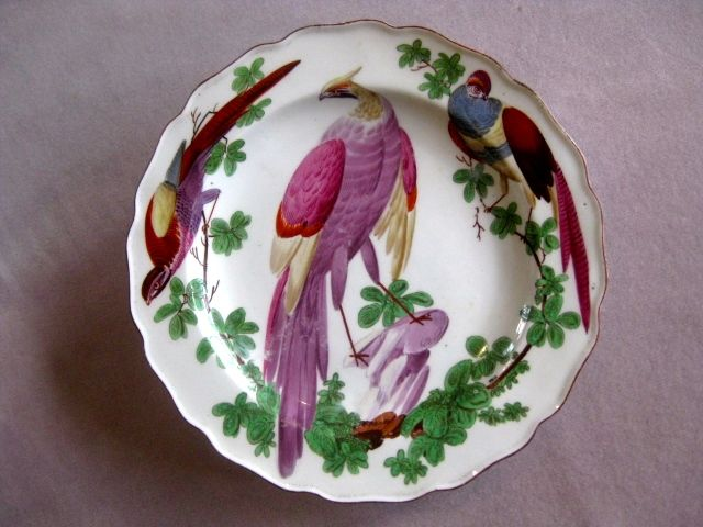A fine Chelsea plate painted with exotic birds, foliage and rocks. Brown lined rim. Brown anchor mark Circa 1760 Width 8 1/4 ""