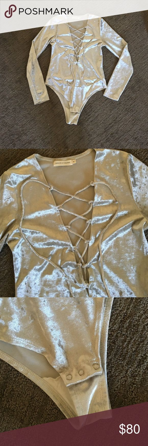 Silver plunging- neckline bodysuit Sexy, crushed velvet-feel leotard. Deep plunging lace-up neck line. Long sleeve with snaps at bottom to open/close. Unworn! Makers of Dreams (indie boutique NYC) Other