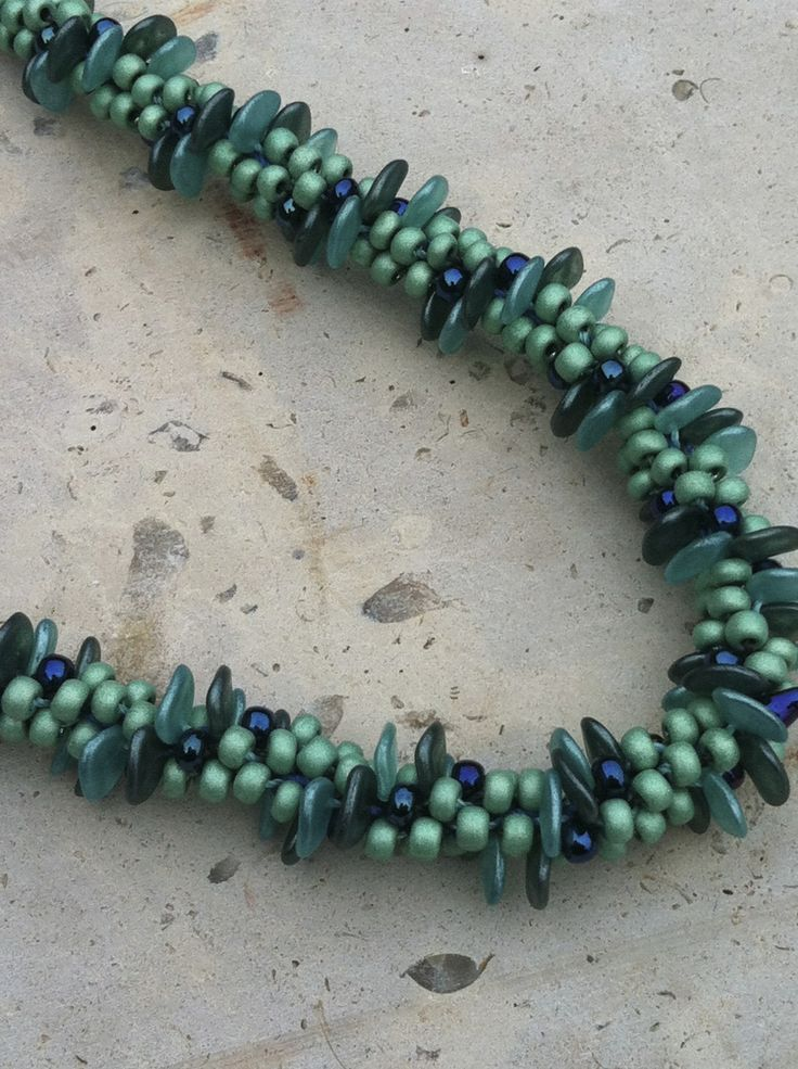 Kumihimo necklace with lentil and seed beads.