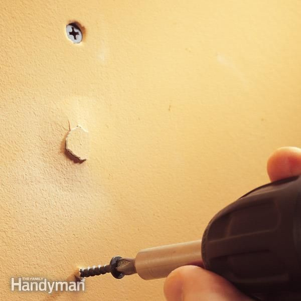 fix drywall nail and screw pops in four simple steps, using drywall screws and drywall compound.