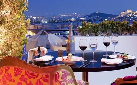 Galaxy bar is on the top floor of the Hilton Hotel, with views of the floodlit Acropolis rising above the city rooftops.