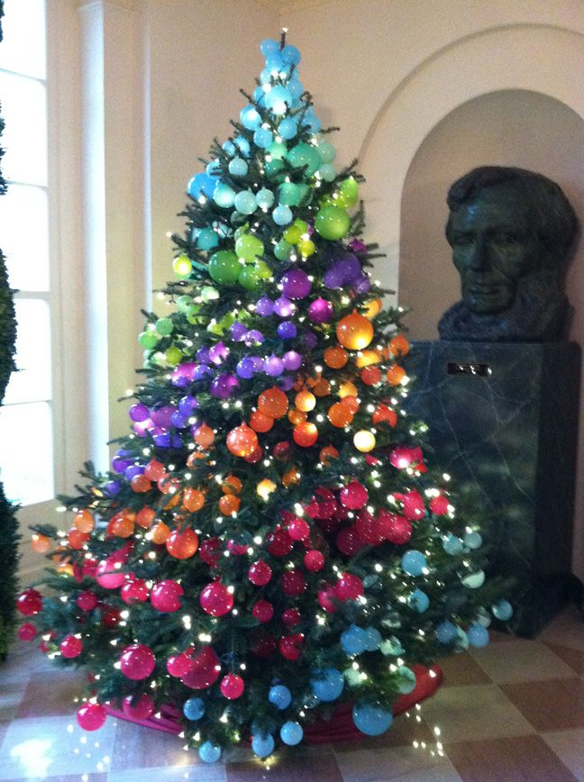•❈• Tree with multicolored ornaments in diagonal stripes. Ombré might be cool.  #Christmas #ChristmasSerendipity