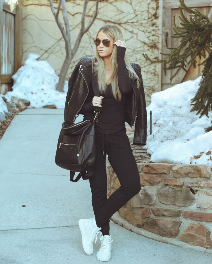 Fashion blogger, Cara Loren in all black with a pop of white Sk8-Hi's.