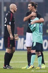Ibraimovic and Messi - This reminds me of the hugs I used to get playing soccer... :p