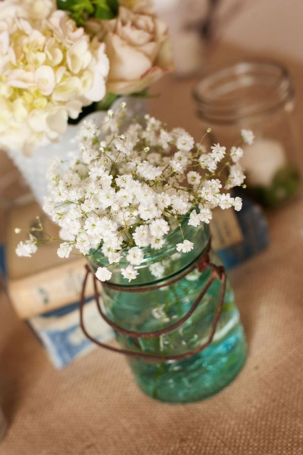 Baby's breath in Mason Jars-another idea for the table to mix in with my daisies in jars.