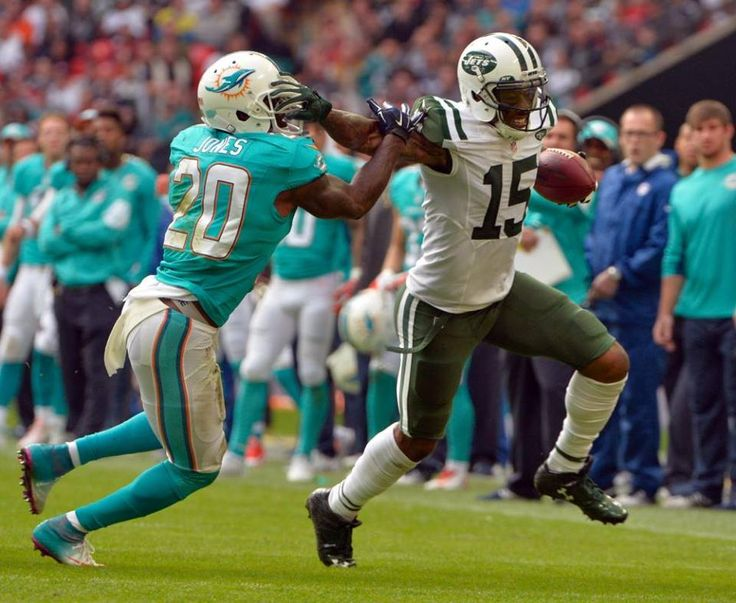 NFL: International Series-New York Jets at Miami Dolphins  -  Oct 4, 2015; London, ENG; New York Jets wide receiver Brandon Marshall (15) runs the ball against Miami Dolphins strong safety Reshad Jones (20) at Wembley Stadium. Mandatory Credit: Steve Flynn-USA TODAY Sports