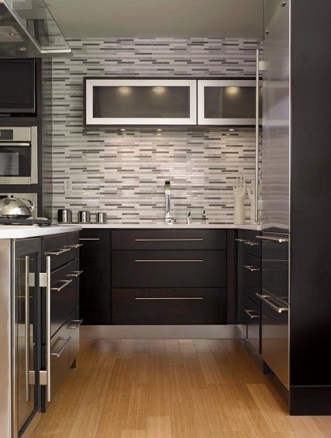 Thin, rectangular tiles can help create an illusion of length in your kitchen. Tiles are a simple tool used to make a room appear bigger. #Tiles #Kitchen