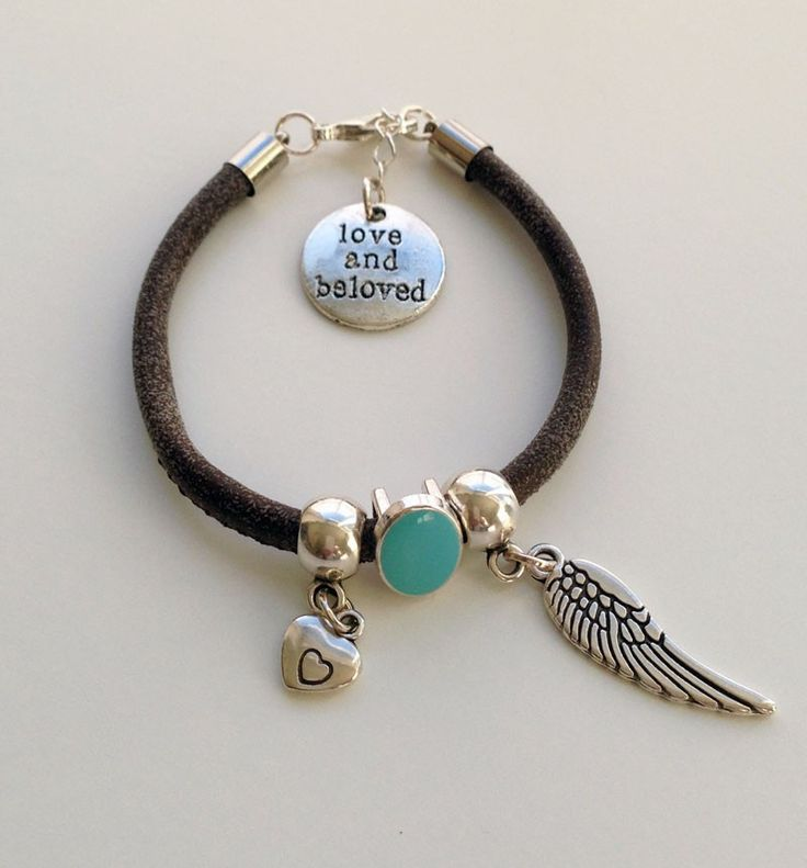 Leren armband Angel Wing. Tough brown leather bracelet with heart charm containing a small heart drawn. Your heart in mine. The Angel Wing Charm to protect love. Love and Beloved!  Also very nice gift for Mom or Mom to Be! http://www.charmantsieraden.nl/mama-sieraden/mama-armbanden/leren-armband-angel-wing.html