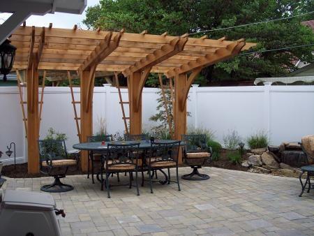 Back yard pergola | Cantilever Pergola Over Unilock Paver Patio | Progressive Lawnscaping