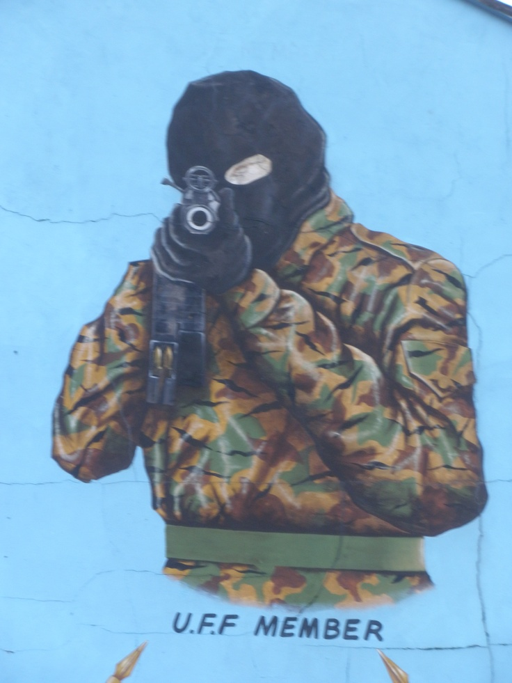A member of the UFF in the wall murals in Belfast. This one is trippy because no matter where you look at him, it is always pointed at you.