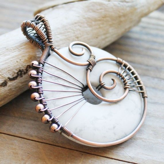 This beautiful howlite donut has been wrapped with a complex swirling design in solid copper beads and wire. Washer idea, could also use for a donut stone