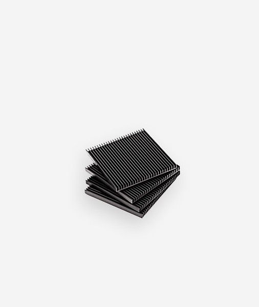 Slim, architectural, and refined, the Fin Coasters are a decidedly modern approach to a traditional tabletop accessory. Designed by Shaun Kasperbauer, the coast