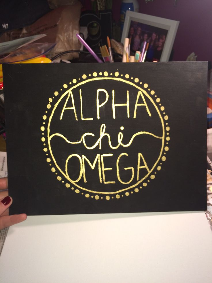 alpha omicron pi painted canvas black and gold, of course.