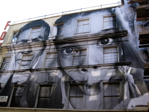 Parisian guerilla street artist JR is this years TED conference winner. With his installations focusing mainly in run-down and low-income areas, JR pastes large-scale close-up images of members from that community attempting to put a human face to impoverished areas.