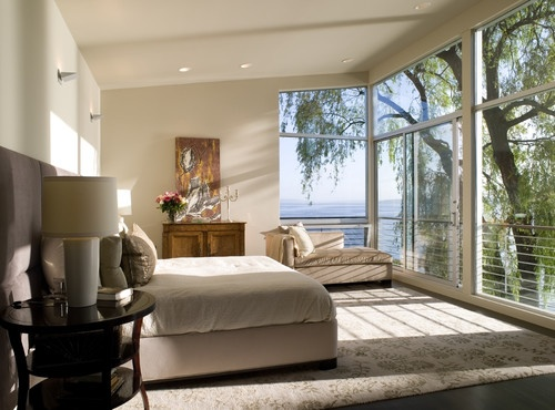Who wouldn't want to wake up to a view like this every morning?     modern bedroom by SHKS Architects