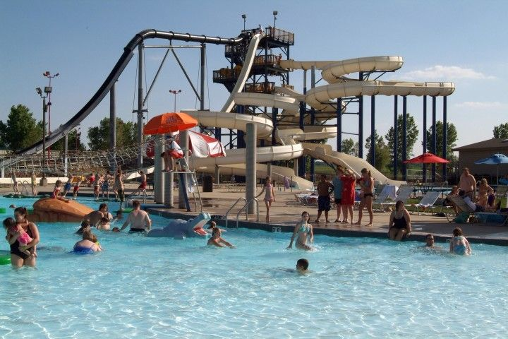 """South Dakota's largest waterpark and only wave pool! Non-stop slides and rides for all ages set in a festive tropical setting. Catch the wave!WAVE POOL-Come see what all the commotion is all about and catch the ultimate wave! Experience South Dakota's only Wave Pool-it's """"GINORMOUS""""!"""
