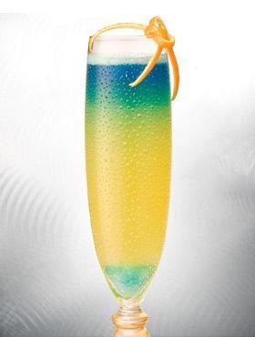 St. Pat's Magic - Korbel Champagne and OJ..Add a blue curacao soaked sugar cube. MAGIC!