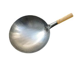Sure, it's a pain in the ass. But take the time and energy to properly season a carbon steel wok and you will be rewarded with a trusty piece of cookery for a lifetime.