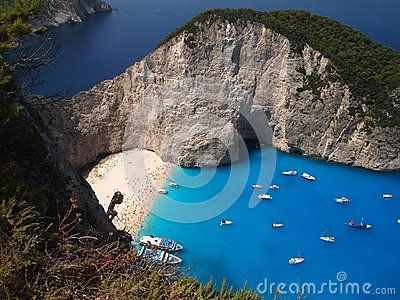 Navagio beach in Zakynthos in Greece. It is a cove on the southwest (northwest near village of Anafonitiria) shore,  by high cliffs and accessible only by boat.