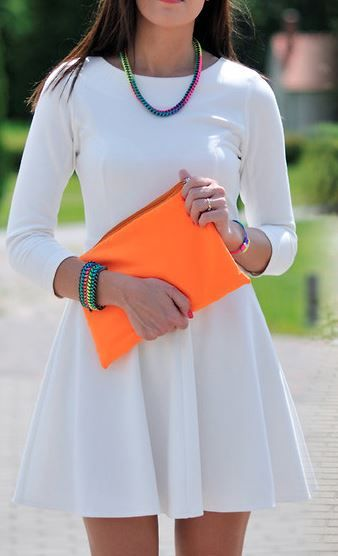 This is a white dress, but with colorful accessories. I like how the orange purse makes the color pop more.