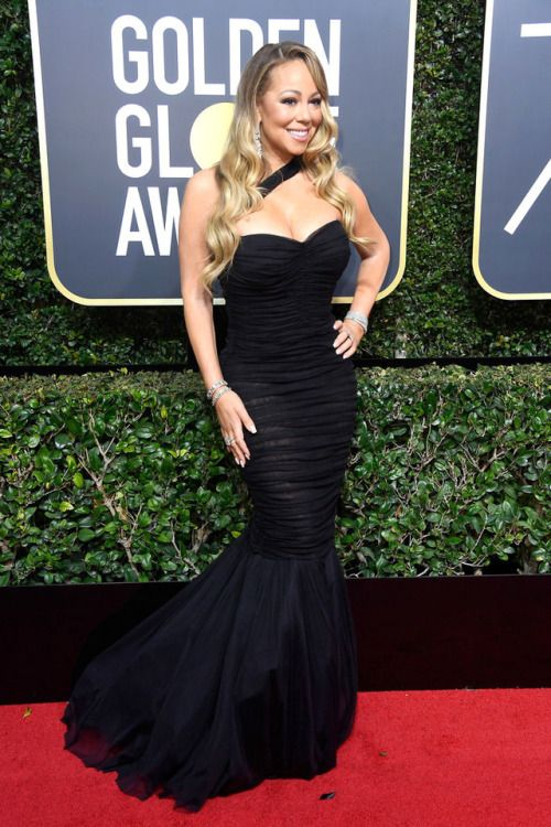Mariah Carey at Golden Globes 2018 : Mariah opted for her signature fish-cut, figure hugging gown by Dolce & Gabbana with some Chopard diamonds and well, she looked good!