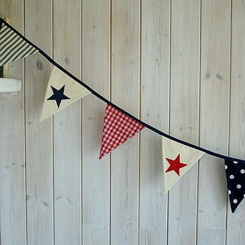 bunting with both colour schemes & designs, to tie in, to make contrasting colours & design somehow congruent.
