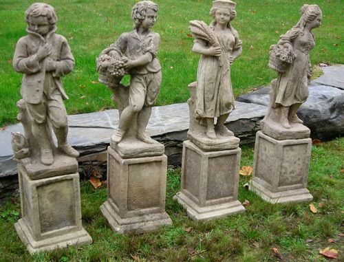 Antique English Cast Stone Garden Statues Depicting The Four Seasons.