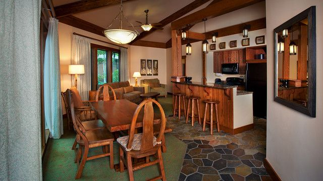 Treehouse Villa at Disney's Saratoga Springs Resort & Spa (A dining table with 4 chairs and a bench near a breakfast counter with 3 stools) 2 Queen Beds and 1 Bunk Bed and 1 Twin-Size Sleeper Chair and 1 Queen-Size Sleeper Sofa Sleeps up to 9 Adults