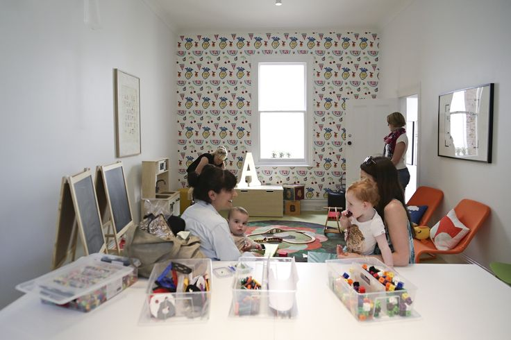 Downstairs play and party room at Habitots. Removable wallpaper designed by Jane Reseiger.