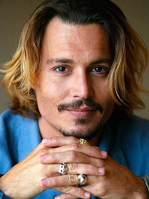 """Johnny Depp: 2003  """"Lovely, lovely, lovely, lovely, lovely,"""" is how Pirates of the Caribbean costar Keira Knightley described 2003's Sexiest Man. Yet Depp (now a father of two with girlfriend Vanessa Paradis), has often opted to bury his flawless features in quirky roles like his Oscar-nominated turn in Pirates. Credit: Damian Dovarganes/AP  Updated: Thursday Nov 03, 2005   06:00 AM EST By: By Serena Kappes"""