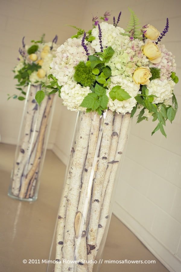 Rustic Ceremony arrangements - beautiful. love the birch wood. seems great for a fallish or spring wedding. might consider something like these!