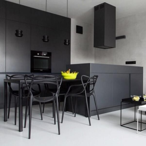 Black kitchen with Masters chair by Philippe Starck #procomobel