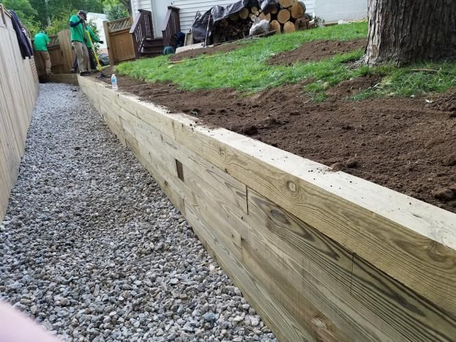 After The Install Of 6x6 Retaining Wall And Crushed Stone Pathway Landscaping Retaining Walls Sloped Backyard Garden Retaining Wall
