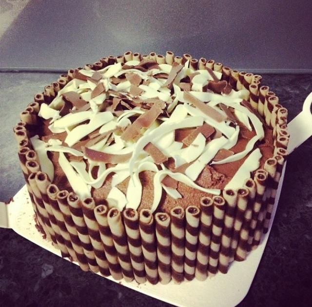 Chocolate mud cake with choc butter cream in the middle and around the outside, with choc/vanilla wafer sticks around the outside and shaved top deck cadbury choc around the outside! #cakesbyleticia