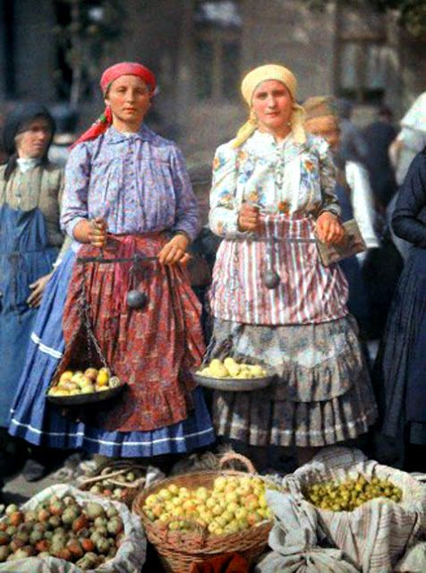 ca. June 1932, Mohacs, Hungary --- Two women sell fruit at the local market