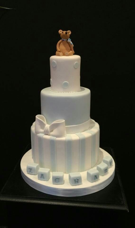Christening cake with a teddy modeled on the invitations .
