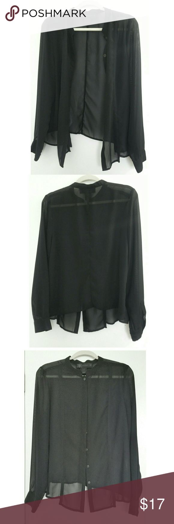 Kardashian Kollection Sheer Black Detailed Blouse This is a button up blouse by Kardashian Kollection size XL. Material is sheer. Hem is slightly asymmetrical and longer in the front than the back. Front has 2 stylish seams going down, very simple but very unique. Beautiful top in great condition. Kardashian Kollection Tops Blouses