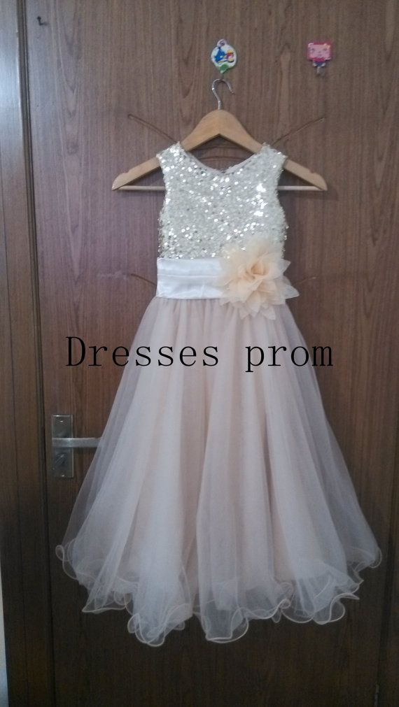 You can chose the standard size or custom make size  Description of flower girl dress Picture shows light champagne color Bridal satin Paillette top+