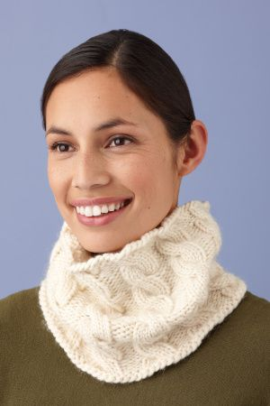 "I wouldn't even want to knit this in a different color, those cables are beautiful.  ""Simple Cable Cowl"" pattern from Lion Brand."